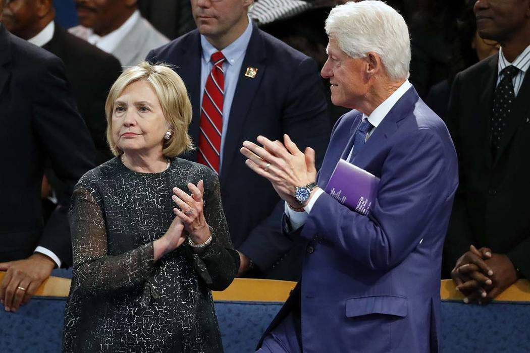 Former President Bill Clinton and wife Hillary Clinton applaud during the funeral for Aretha Franklin at Greater Grace Temple, Friday, Aug. 31, 2018, in Detroit. The Clintons will be coming to Las ...