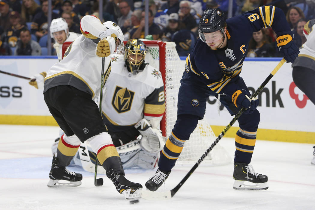 Buffalo Sabres forward Jack Eichel (15) passes the puck in front of Vegas Golden Knights goalie Marc-Andre Fleury (29) during the third period of an NHL hockey game, Monday, Oct. 8, 2018, in Buffa ...