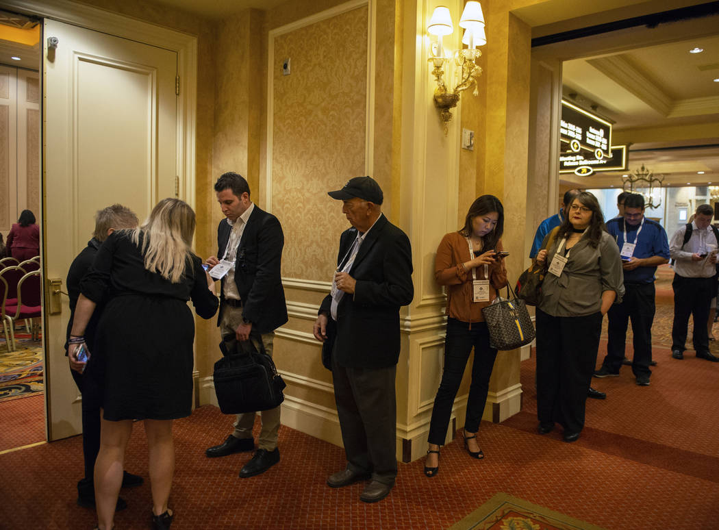 Attendees of the Global Gaming Expo (G2E), hosted by the American Gaming Association, line up in a hall waiting to attend the next panel as the G2E kicks off its first day at the Sands Expo in Las ...