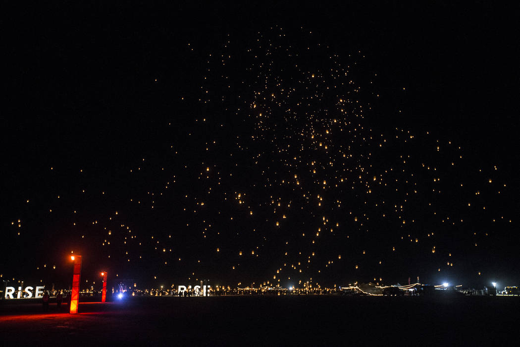 Participants release their lanterns during the RiSE Lantern Festival at Jean Dry Lake Bed on Friday, Oct. 5, 2018, in Jean, Nevada. Benjamin Hager Las Vegas Review-Journal @benjaminhphoto