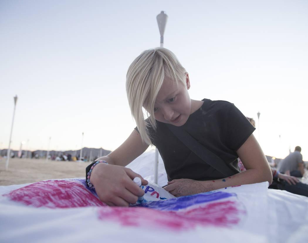 Keeley Milner designs her lantern during the RiSE Lantern Festival at Jean Dry Lake Bed on Friday, Oct. 5, 2018, in Jean, Nevada. Benjamin Hager Las Vegas Review-Journal @benjaminhphoto