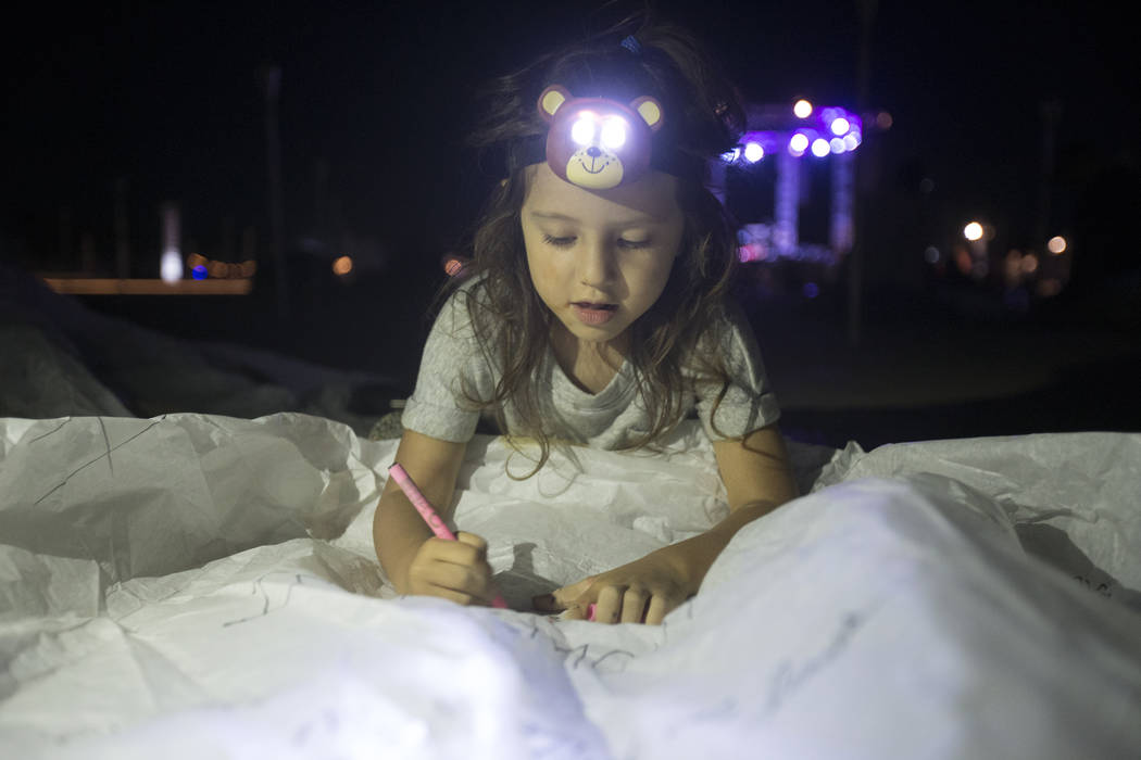 Charlize Torres, from Upland, Calif., designs her lantern during the RiSE Lantern Festival at Jean Dry Lake Bed on Friday, Oct. 5, 2018, in Jean, Nevada. Benjamin Hager Las Vegas Review-Journal @b ...