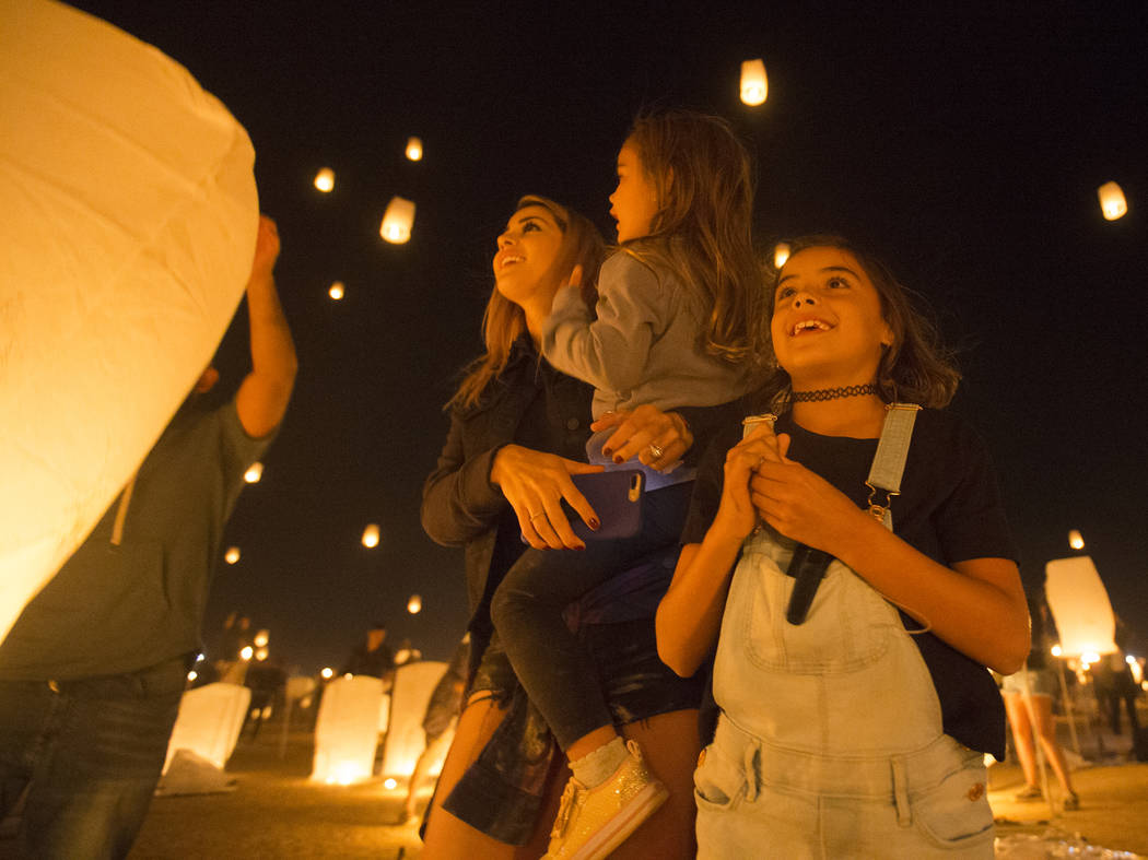 Jessica, June and Jade Laos watch their lanterns fly into the sky during the RiSE Lantern Festival at Jean Dry Lake Bed on Friday, Oct. 5, 2018, in Jean, Nevada. Benjamin Hager Las Vegas Review-Jo ...
