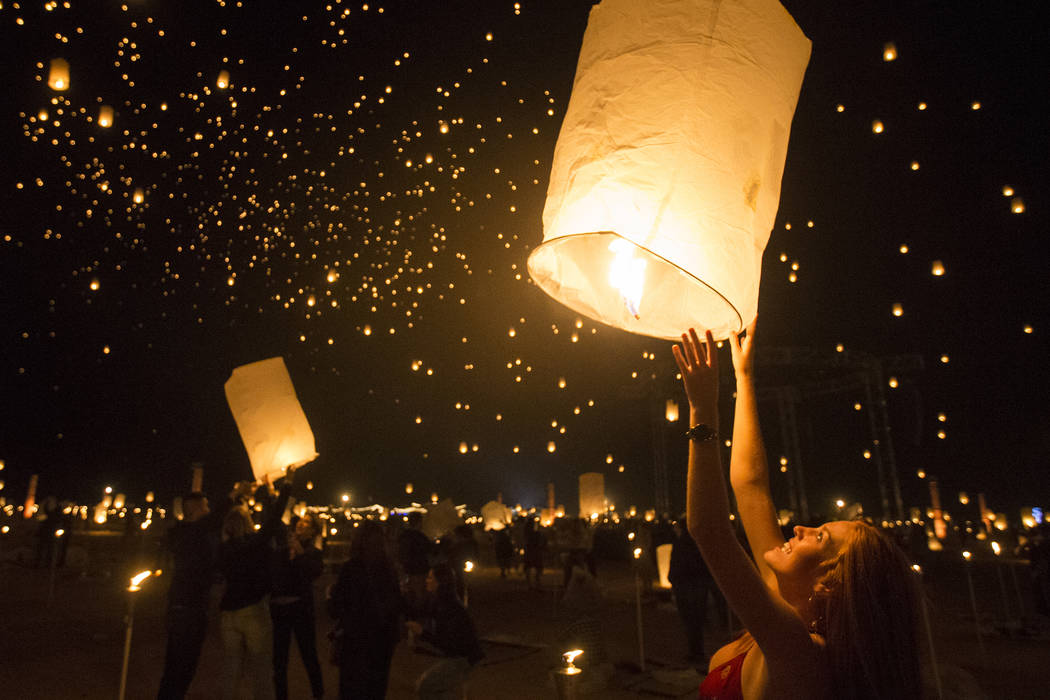 Delaney Evans releases her lantern during the RiSE Lantern Festival at Jean Dry Lake Bed on Friday, Oct. 5, 2018, in Jean, Nevada. Benjamin Hager Las Vegas Review-Journal @benjaminhphoto