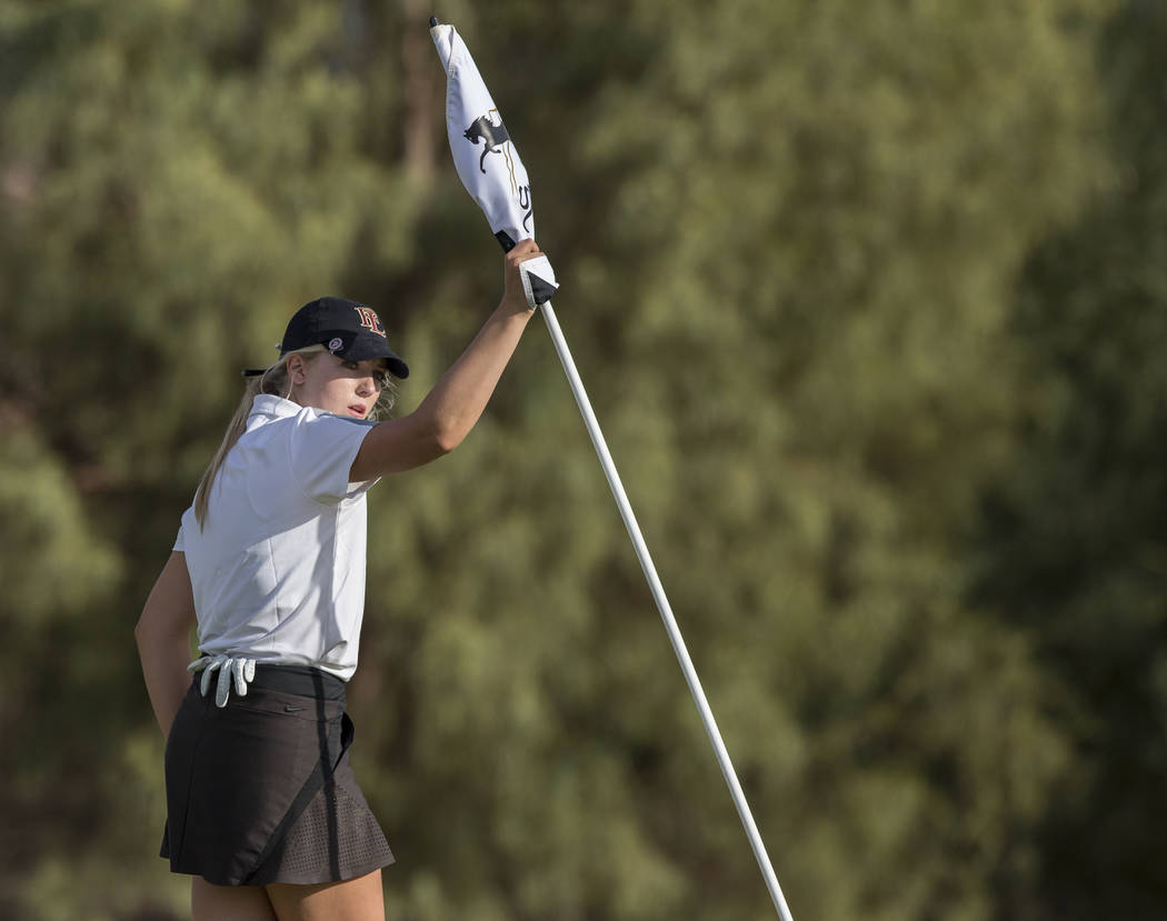 Faith Lutheran sophomore Gracie Olkowski pulls the flag after reaching the green at Stallion Mountain Golf Club on Wednesday, Oct. 10, 2018, in Las Vegas. Benjamin Hager Las Vegas Review-Journal @ ...