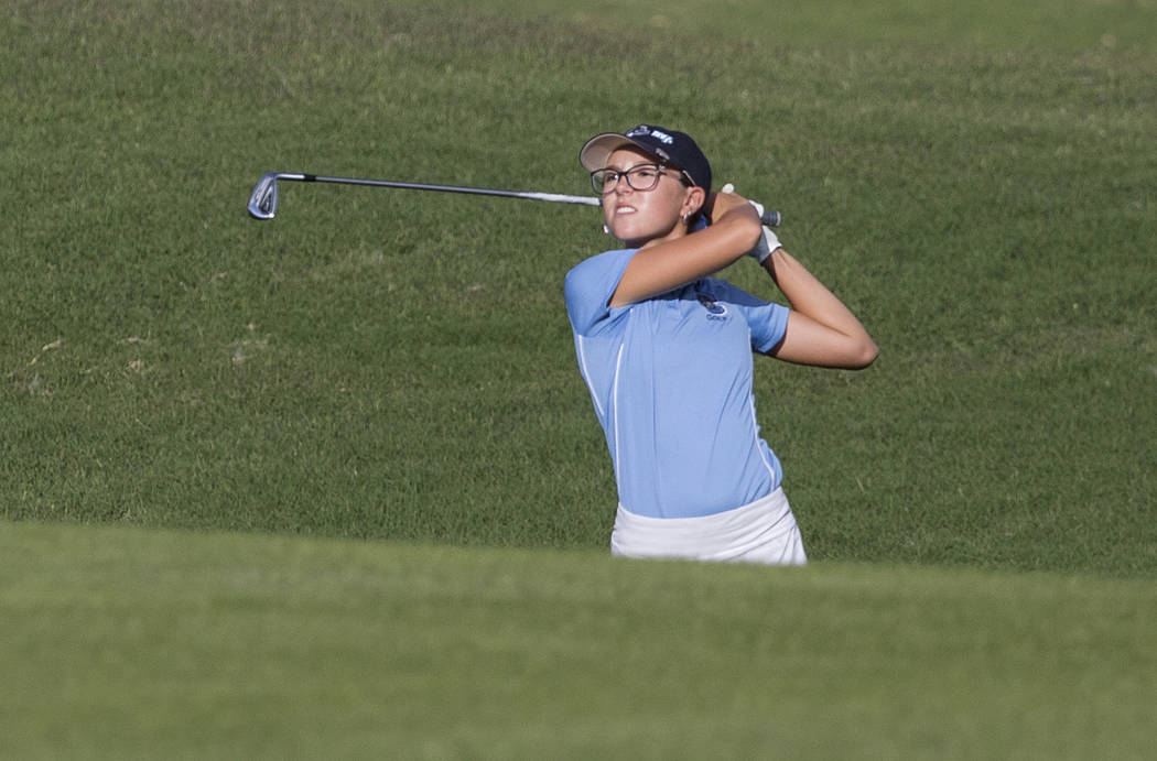 Centennial sophomore McKenzi Hall hits an iron out of the ruff at Stallion Mountain Golf Club on Wednesday, Oct. 10, 2018, in Las Vegas. Benjamin Hager Las Vegas Review-Journal @benjaminhphoto