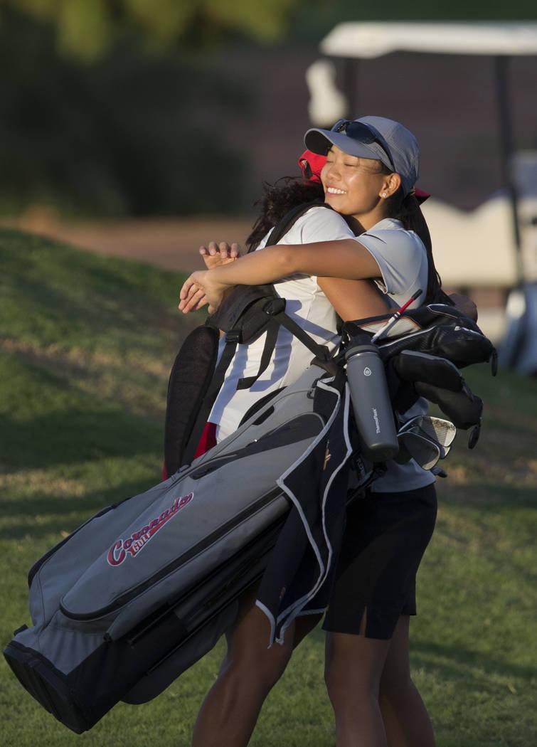 Clark sophomore Riana Mission, right, hugs Coronado's Victoria Estrada after winning the region golf tournament at Stallion Mountain Golf Club on Wednesday, Oct. 10, 2018, in Las Vegas. Benjamin ...