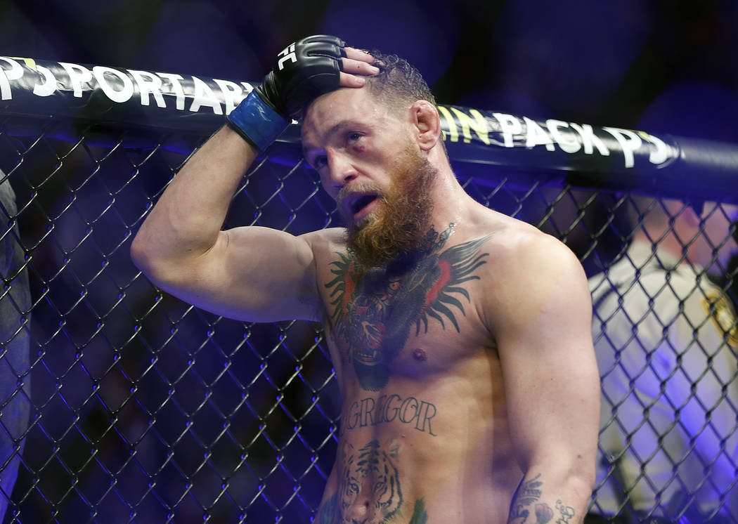 Conor McGregor reacts after losing to Khabib Nurmagomedov in a lightweight title mixed martial arts bout at UFC 229 in Las Vegas, Saturday, Oct. 6, 2018. Nurmagomedov won the fight by submission d ...