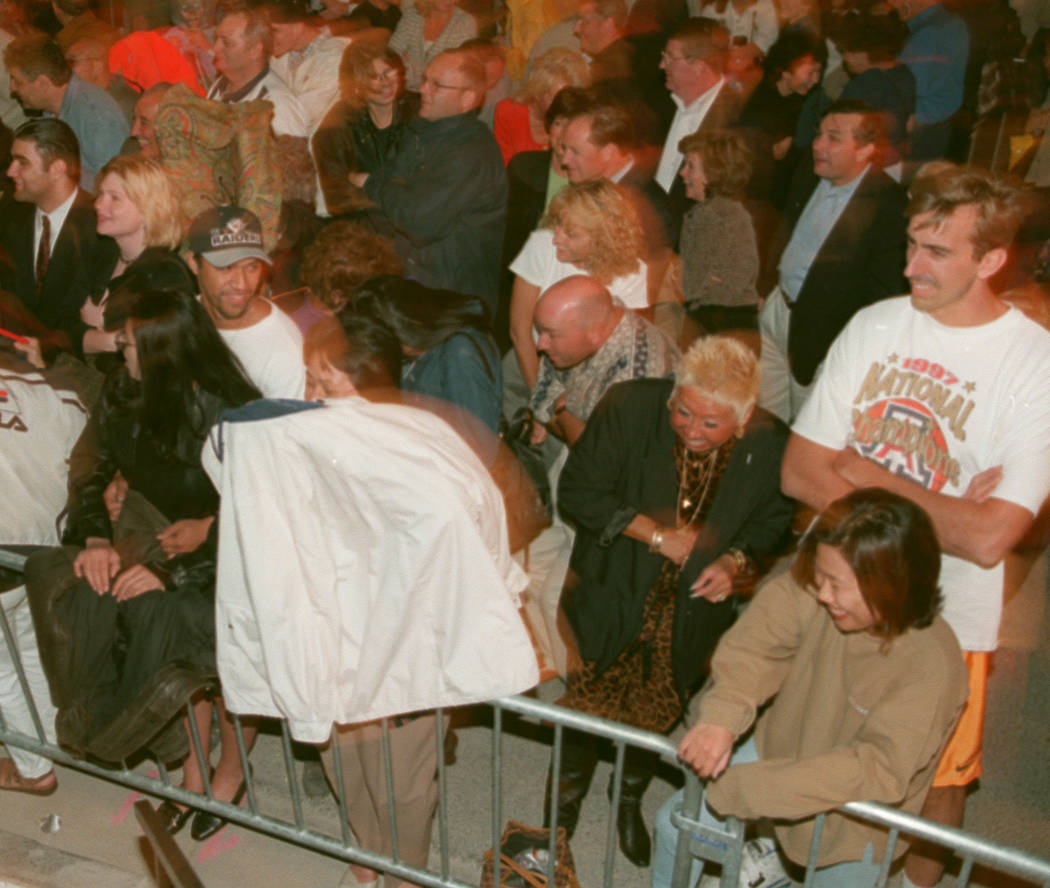 Spectators duck for cover as the wind blown mist hits them during the pre opening events at the Bellagio in 1998. (RJ File Photo)