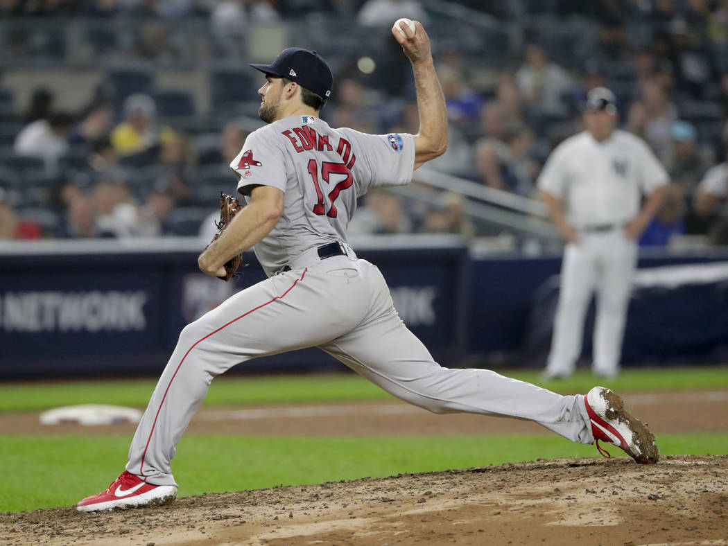 Boston Red Sox starting pitcher Nathan Eovaldi (17) delivers against the New York Yankees during the fourth inning of Game 3 of baseball's American League Division Series, Monday, Oct. 8, 2018, in ...