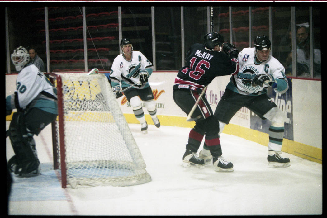 Jim Kyte, far right, of the Las Vegas Thunder skates behind the net against the San Diego Gulls in an International Hockey League game