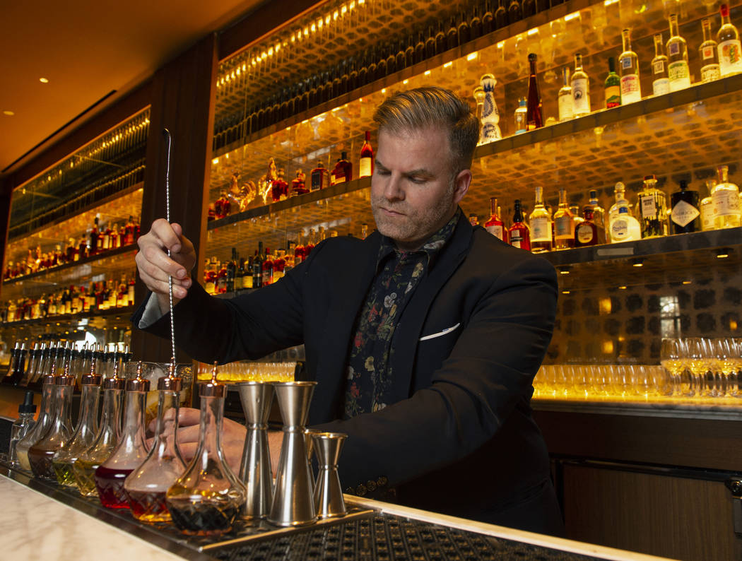 "Leo Robitschek, the managing partner and bar director, makes a ""detox-retox"" cocktail at the NoMad Bar and Restaurant in Park MGM in Las Vegas, Monday, Oct. 8, 2018. Caroline Brehman/Las ..."