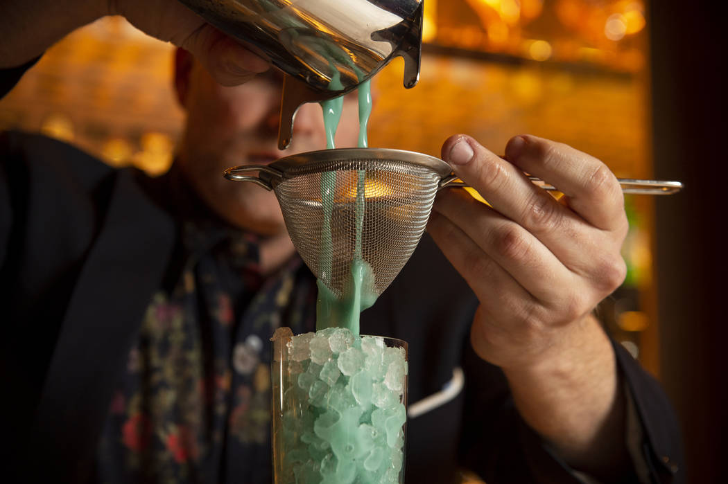 "Leo Robitschek, the managing partner and bar director, makes a ""Blue Hawaiian"" cocktail at the NoMad Bar and Restaurant in Park MGM in Las Vegas, Monday, Oct. 8, 2018. Caroline Brehman/L ..."