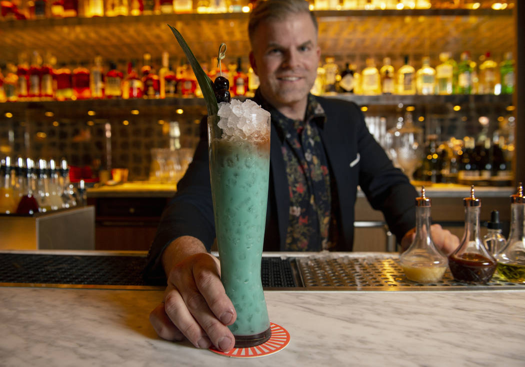 "Leo Robitschek, the managing partner and bar director, shows off his finished ""Blue Hawaiian"" cocktail at the NoMad Bar and Restaurant in Park MGM in Las Vegas, Monday, Oct. 8, 2018. Car ..."