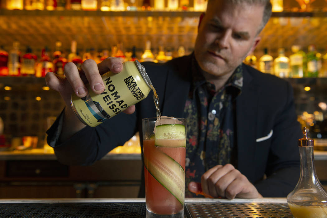 "Leo Robitschek, the managing partner and bar director, makes a ""Bogs and Barley"" cocktail at the NoMad Bar and Restaurant in Park MGM in Las Vegas, Monday, Oct. 8, 2018. Caroline Brehman ..."