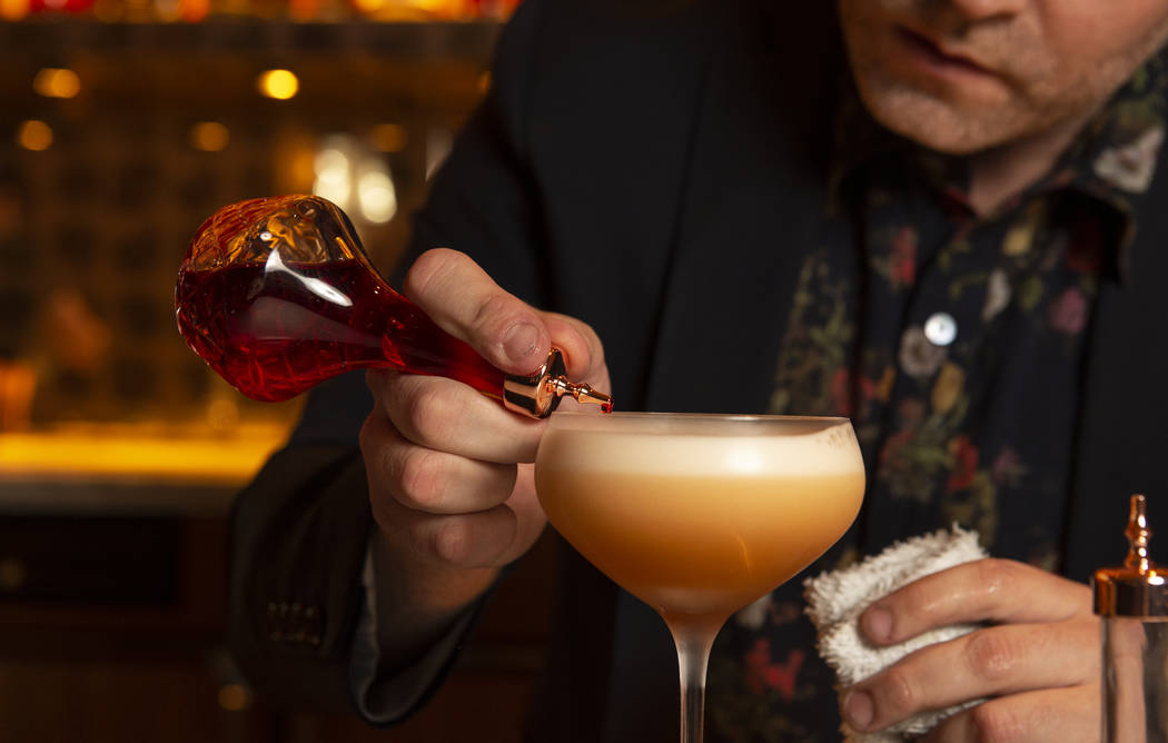 "Leo Robitschek, the managing partner and bar director, makes a ""Amaretto Sour"" cocktail at the NoMad Bar and Restaurant in Park MGM in Las Vegas, Monday, Oct. 8, 2018. Caroline Brehman/L ..."