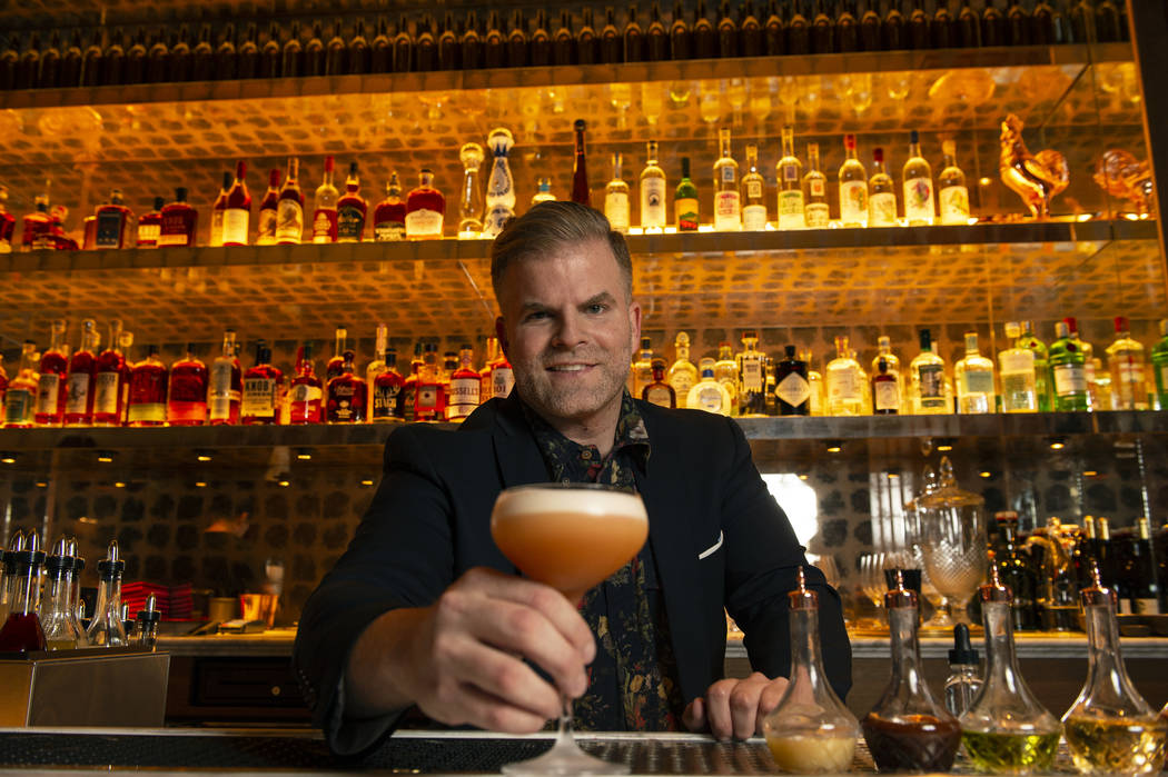 "Leo Robitschek, the managing partner and bar director, shows off his finished ""Amaretto Sour"" cocktail at the NoMad Bar and Restaurant in Park MGM in Las Vegas, Monday, Oct. 8, 2018. Car ..."