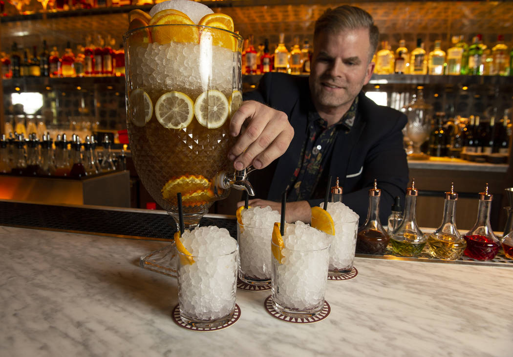 "Leo Robitschek, the managing partner and bar director, pours an ""American in Rome"" cocktail at the NoMad Bar and Restaurant in Park MGM in Las Vegas, Monday, Oct. 8, 2018. Caroline Brehm ..."