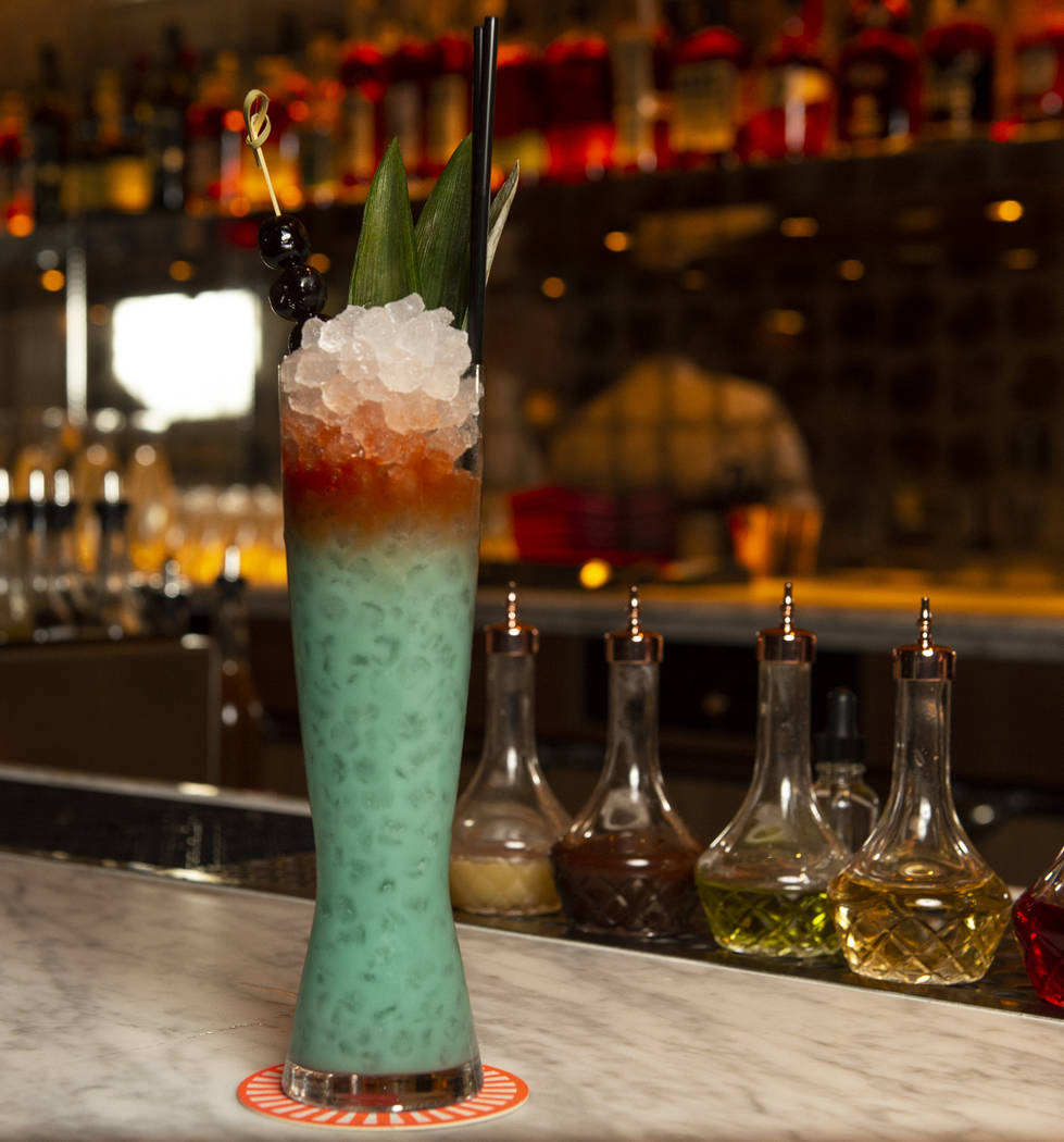 "The ""Blue Hawaiian cocktail is made up of Guatemalan rum, green chartreuse, coconut, pineapple, and lime at the NoMad Bar and Restaurant in Park MGM in Las Vegas, Monday, Oct. 8, 2018. Caroli ..."