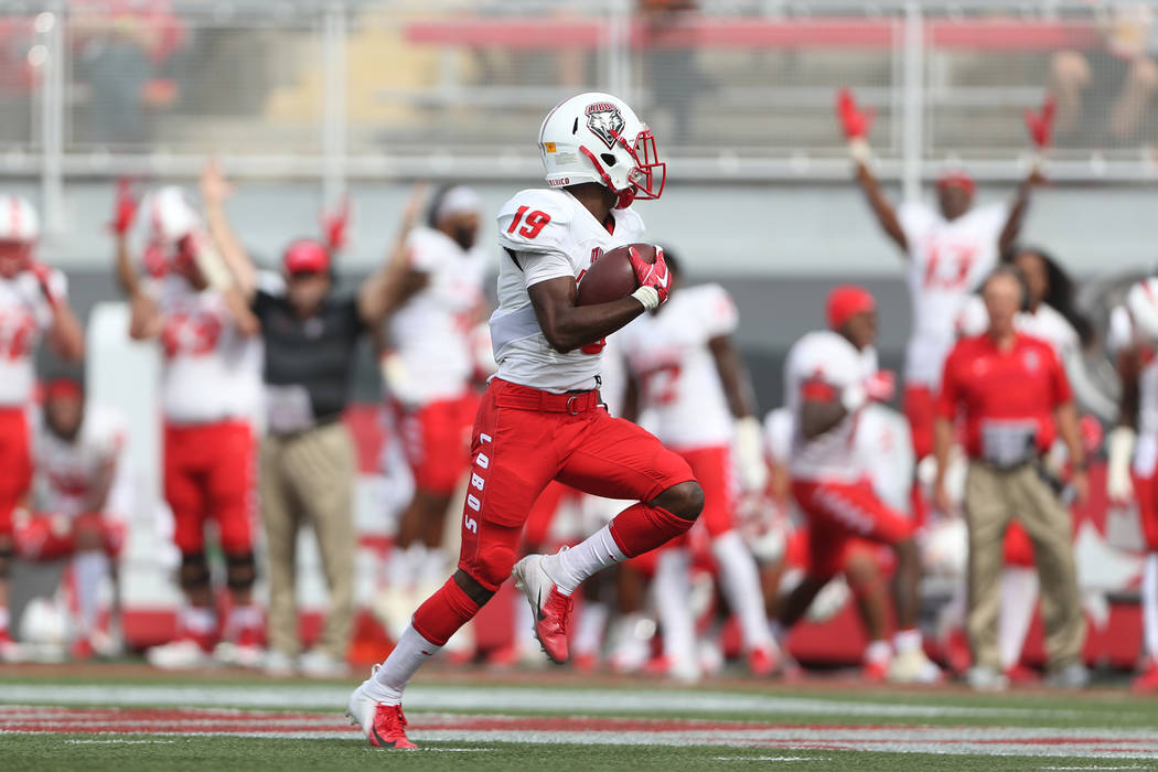 New Mexico Lobos wide receiver Elijah Lilly (19) runs the ball for a touchdown after a catch in the second quarter against UNLV Rebels at Sam Boyd Stadium in Las Vegas, Saturday, Oct. 6, 2018. Eri ...