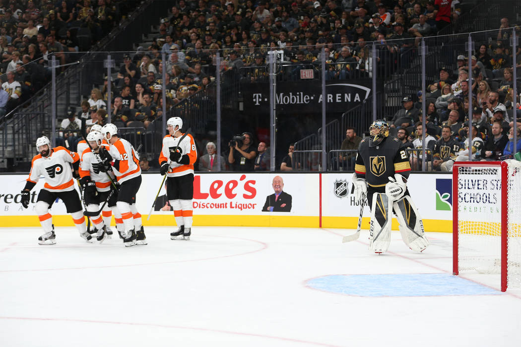 Vegas Golden Knights goaltender Marc-Andre Fleury (29), right, looks on as Philadelphia Flyers celebrates a goal in the second period of a hockey game at T-Mobile Arena in Las Vegas, Thursday, Oct ...