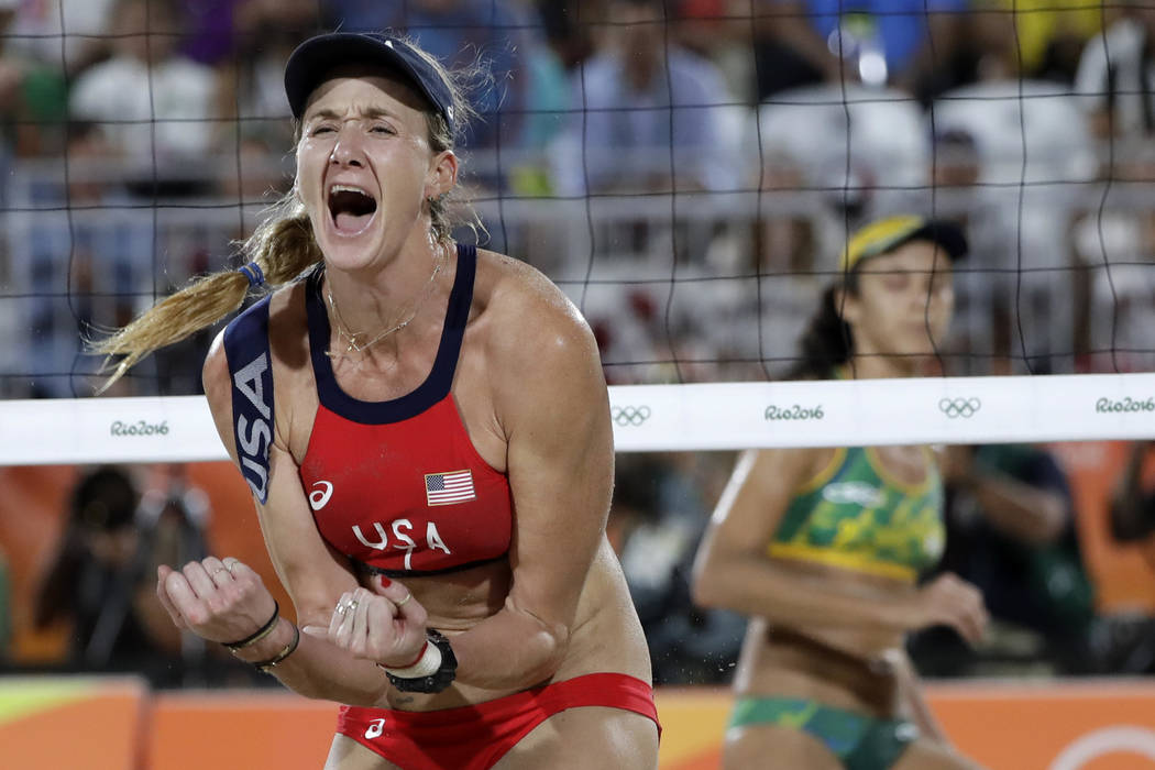 FILE - In this Aug. 17, 2016, file photo, United States' Kerri Walsh Jennings reacts while playing Brazil during the women's beach volleyball bronze medal match of the 2016 Summer Olympics in Rio ...