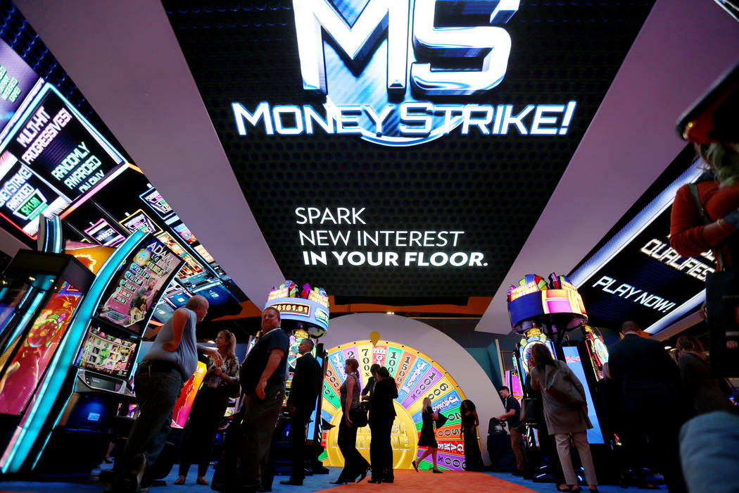Conventioneers play the Wheel of Fortune game in the IGT booth at the 18th annual Global Gaming Expo at Sands Expo and Convention Center in Las Vegas Tuesday, Oct. 9, 2018. G2E runs through Thurs ...