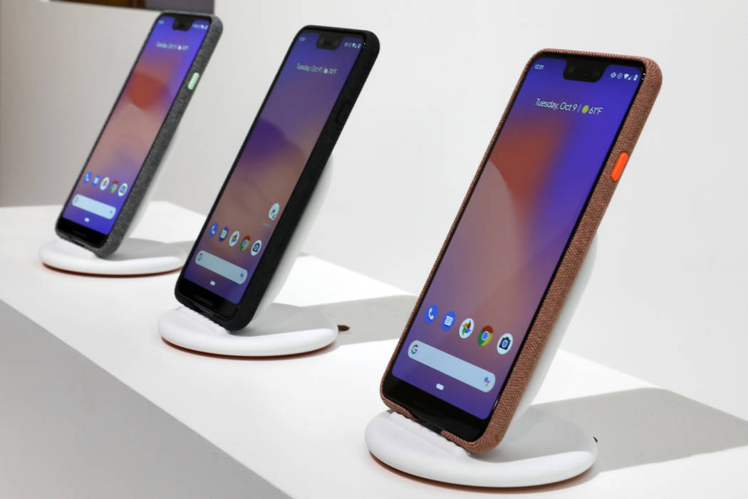New Google Pixel 3 smartphones are displayed in New York, Tuesday, Oct. 9, 2018. Google introduced two new smartphones in its relentless push to increase the usage of its digital services and prom ...