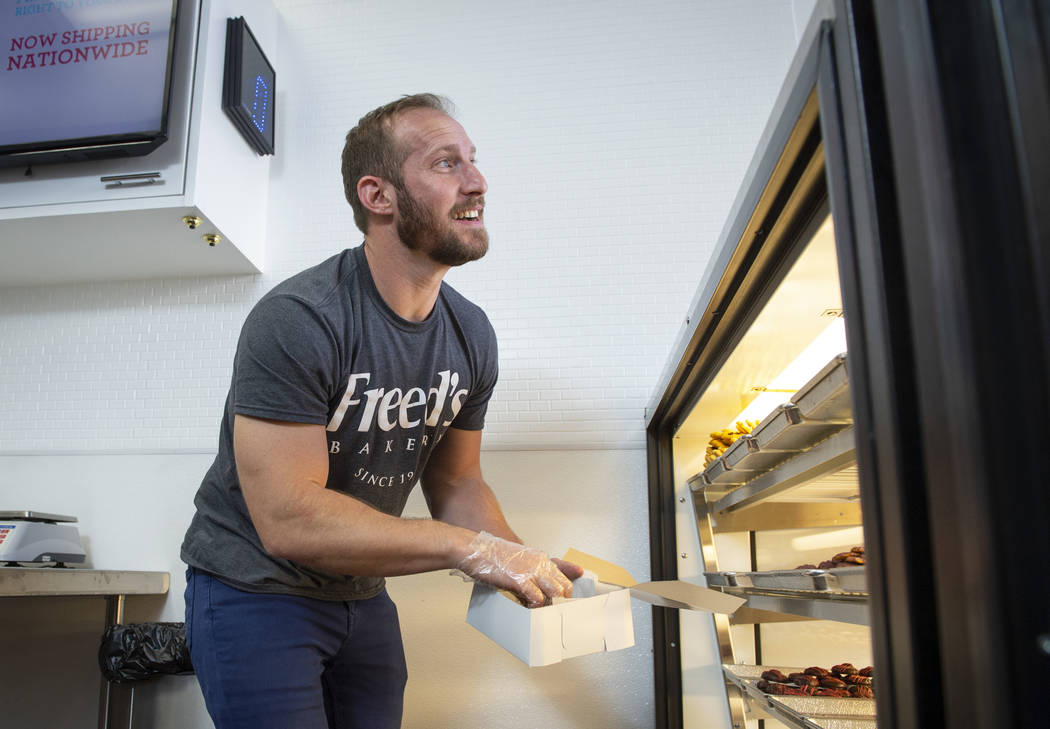 Max Jacobson-Fried, owner of Freed's Bakery, places a cookie in a container to box up in Freed's newest location at 6475 N. Decatur Blvd. in the Shadow Mountain Marketplace, just north of the nort ...