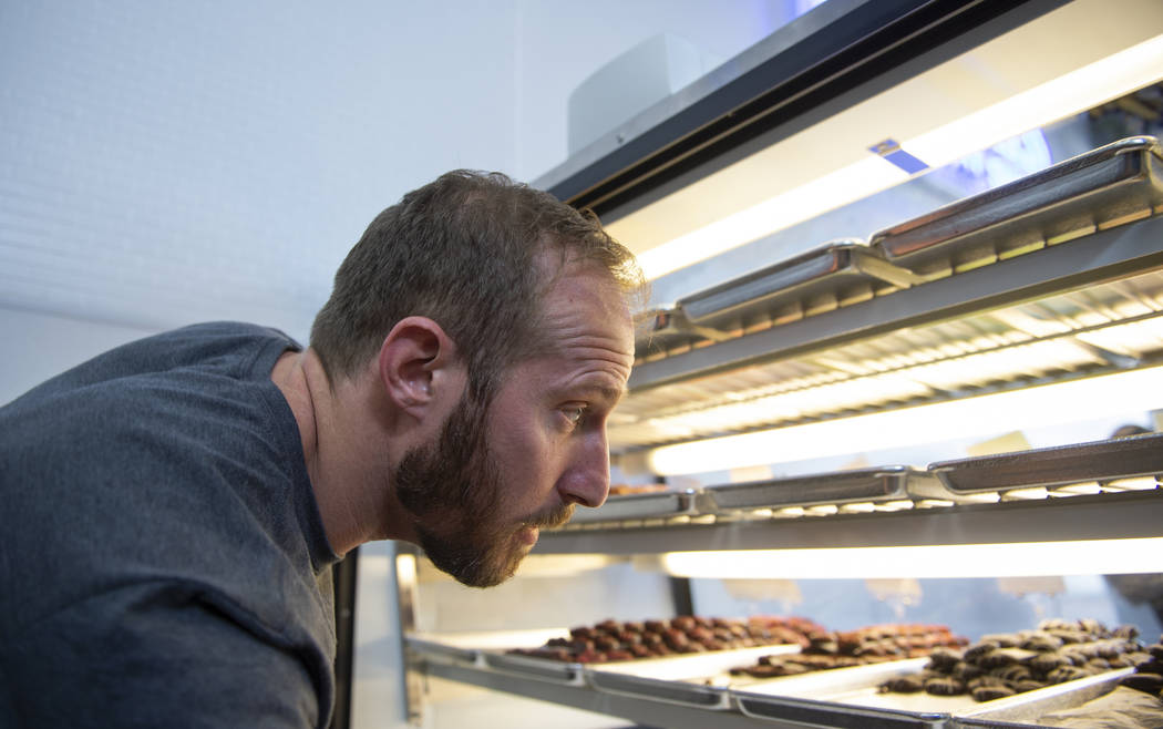 Max Jacobson-Fried, owner of Freed's Bakery, boxes up various sweet treats in Freed's newest location at 6475 N. Decatur Blvd. in the Shadow Mountain Marketplace, just north of the northern 215 Be ...