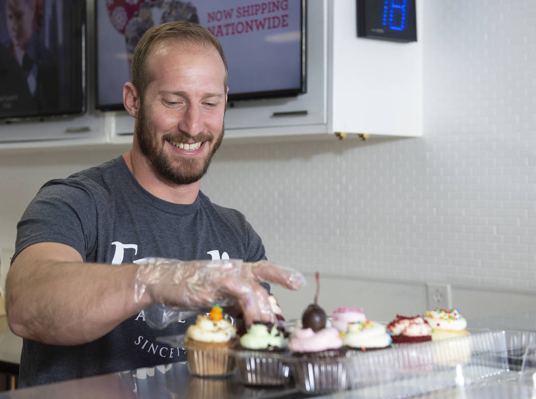 Max Jacobson-Fried, owner of Freed's Bakery, places different kinds of cupcakes in a holding container in Freed's newest location at 6475 N. Decatur Blvd. in the Shadow Mountain Marketplace, just ...