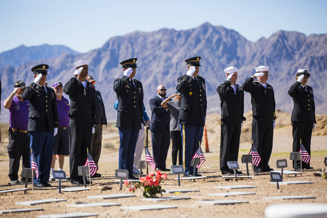 The remains of 12 veterans and one spouse are saluted after being honorably transferred to their final resting place during the Missing in Nevada ceremony held at the Southern Nevada Veterans Memo ...