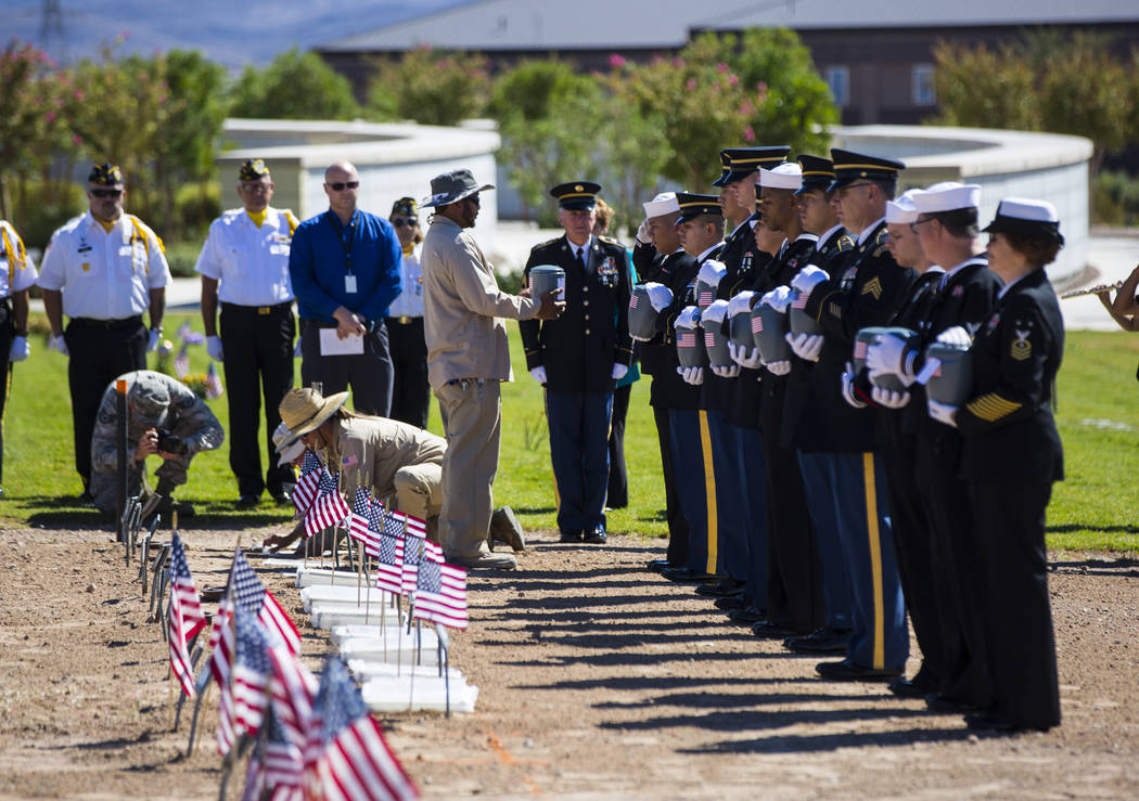 The remains of 12 veterans and one spouse are honorably transferred to their final resting place during the Missing in Nevada ceremony held at the Southern Nevada Veterans Memorial Cemetery in Bou ...