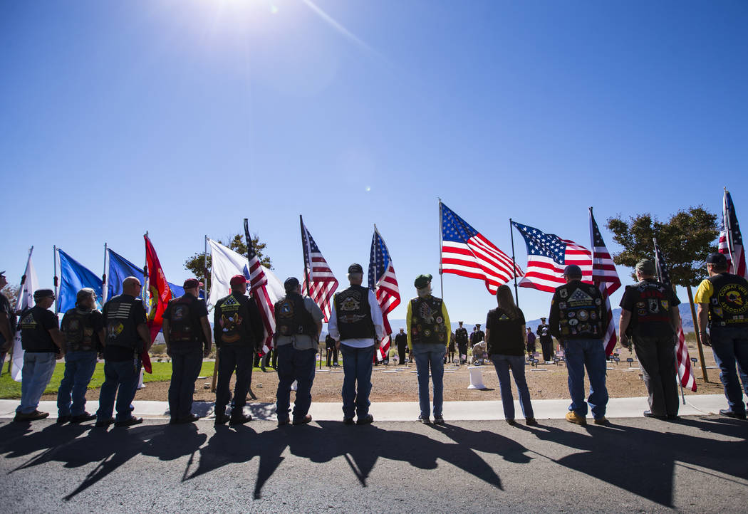 Members of the Patriot Guard Riders of Nevada hold up flags during the Missing in Nevada ceremony held at the Southern Nevada Veterans Memorial Cemetery in Boulder City on Tuesday, Oct. 9, 2018. C ...