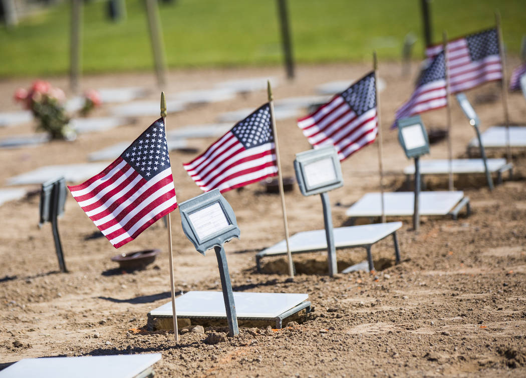 The remains of 12 veterans and one spouse, including, including Army veteran Charles Teneyck, who passed away in 1991 and served in World War II, left, after being honorably transferred to their f ...
