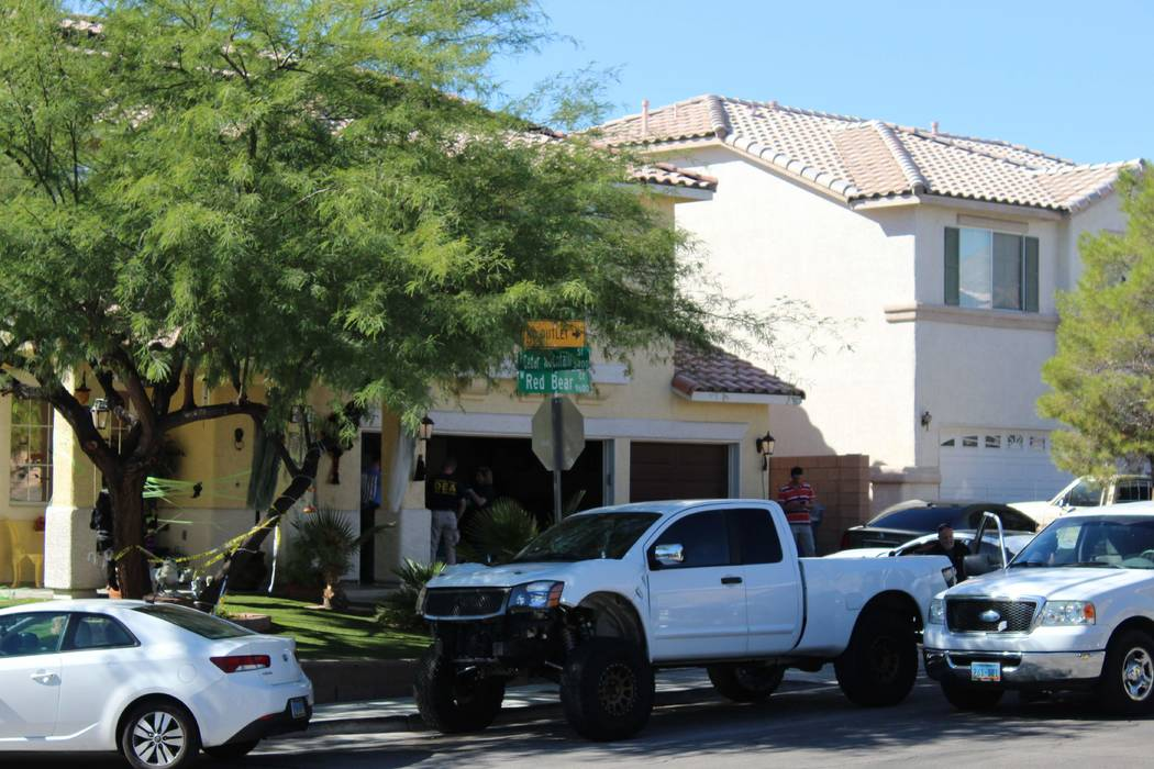 FBI and Drug Enforcement Administration agents are seen inside and outside a home on the 9600 block of Red Bear Court in Las Vegas on Tuesday, Oct. 9, 2018. (Max Michor/Las Vegas Review-Journal)