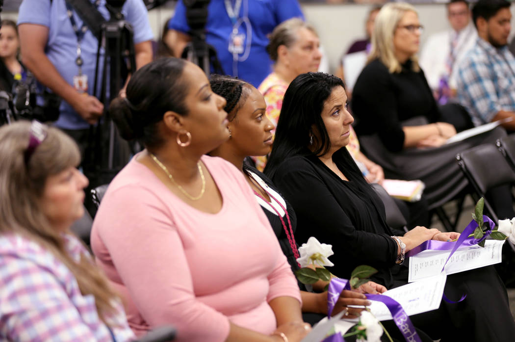 Tammy Cutler, from left, Yamille Muriel, Jesse James and Nancy Hernandez during a Community Coalition for Victims Rights and Metropolitan Police Department ceremony at the Southern Nevada Family J ...