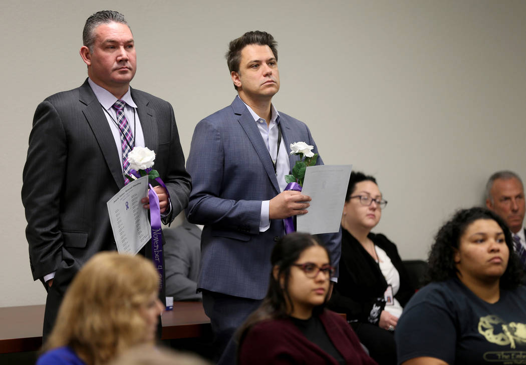 Capt. Sean Thoman, left, and Lt. Leon DeSimone during a Community Coalition for Victims Rights and Metropolitan Police Department ceremony at the Southern Nevada Family Justice Center in Las Vegas ...