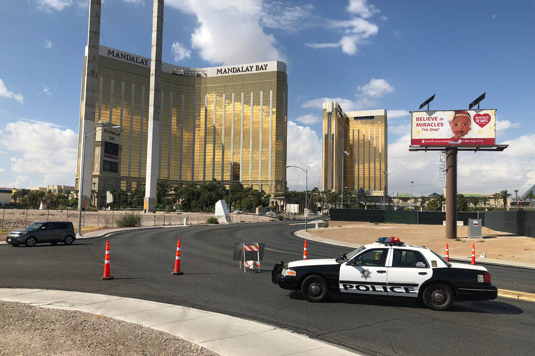 On Oct. 1, 2018, a police car blocks Giles Road behind the grounds where the Route 91 Harvest festival was held a year earlier. (Todd Prince/Las Vegas Review-Journal)