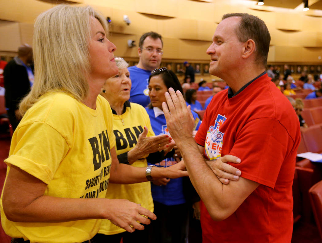 Carol Fata, left, who is for a proposal to stop licensing short-term rentals, argues with Chris Davies, who is against the proposal, before a Las Vegas Planning Commission meeting at City Hall Tue ...