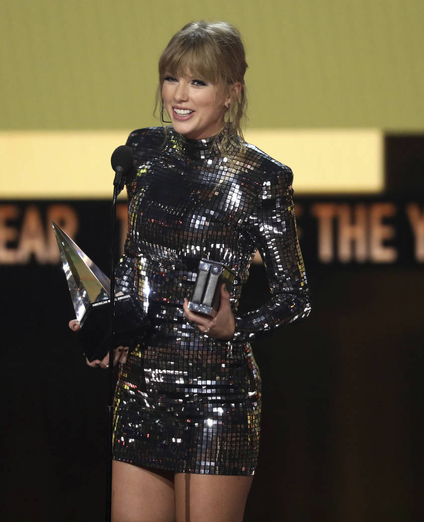 Taylor Swift accepts the award for tour of the year at the American Music Awards on Tuesday, Oct. 9, 2018, at the Microsoft Theater in Los Angeles. (Photo by Matt Sayles/Invision/AP)