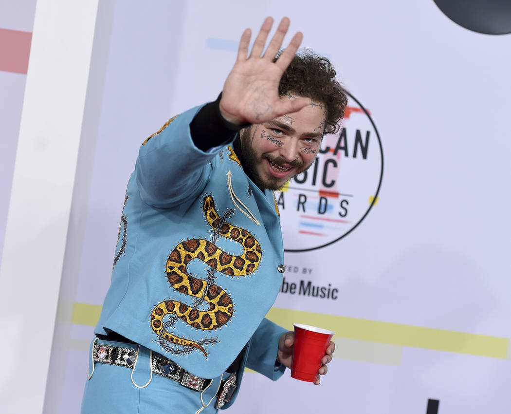 Post Malone arrives at the American Music Awards on Tuesday, Oct. 9, 2018, at the Microsoft Theater in Los Angeles. (Photo by Jordan Strauss/Invision/AP)