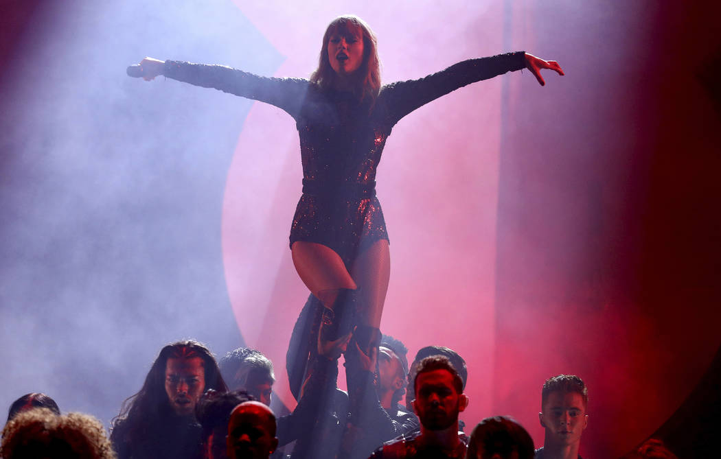 "Taylor Swift performs ""I Did Something Bad"" at the American Music Awards on Tuesday, Oct. 9, 2018, at the Microsoft Theater in Los Angeles. (Photo by Matt Sayles/Invision/AP)"