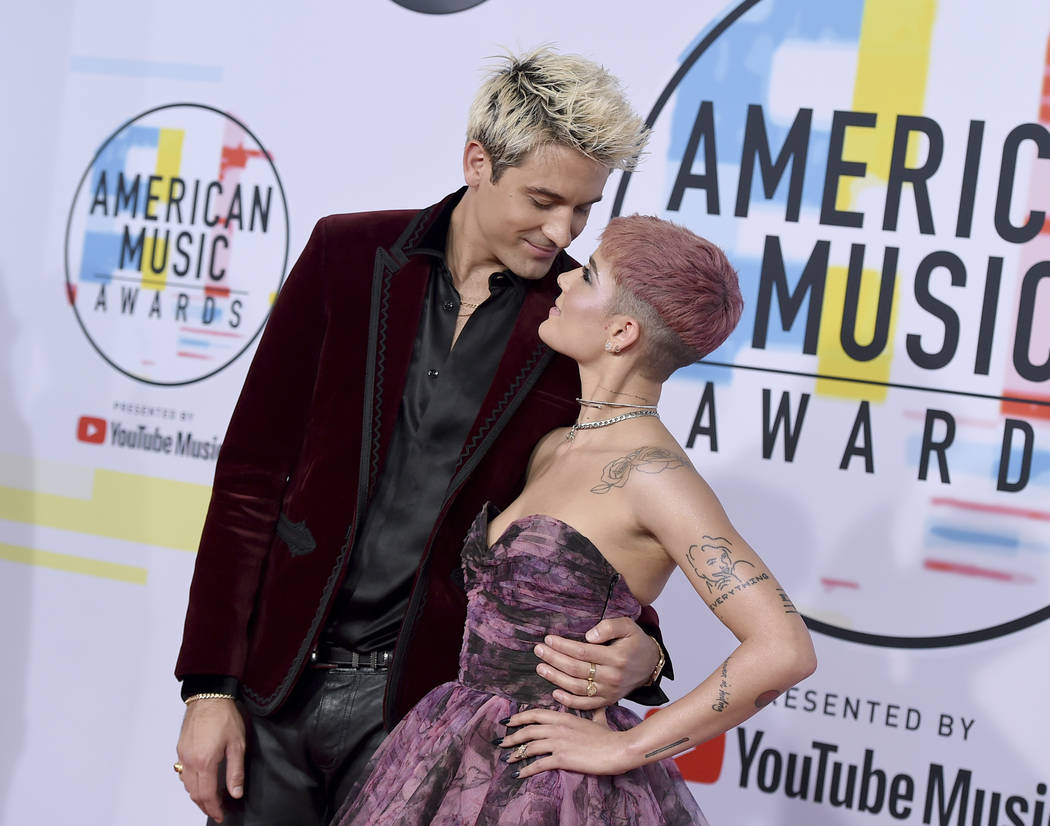 G-Eazy, left, and Halsey arrive at the American Music Awards on Tuesday, Oct. 9, 2018, at the Microsoft Theater in Los Angeles. (Photo by Jordan Strauss/Invision/AP)