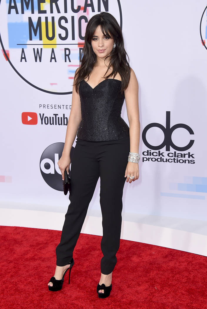 Camila Cabello arrives at the American Music Awards on Tuesday, Oct. 9, 2018, at the Microsoft Theater in Los Angeles. (Photo by Jordan Strauss/Invision/AP)