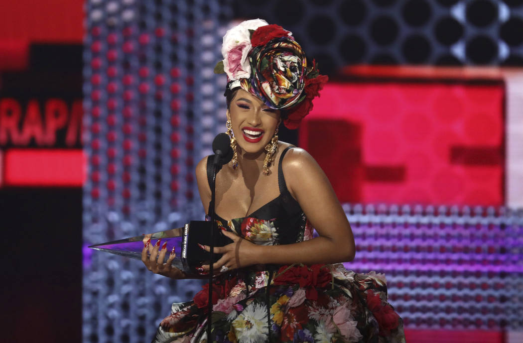 Cardi B accepts the award for favorite rap/hip-hop artist at the American Music Awards on Tuesday, Oct. 9, 2018, at the Microsoft Theater in Los Angeles. (Photo by Matt Sayles/Invision/AP)
