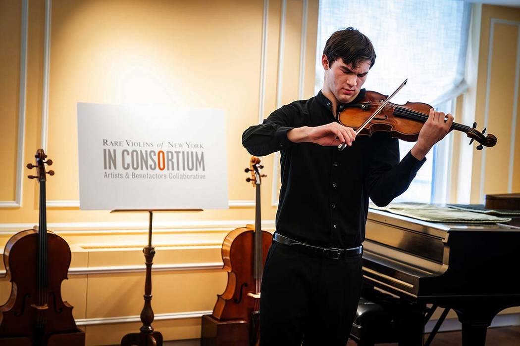"In this photo provided by Chris Lee, Juilliard student Nathan Meltzer, recipient of the ""Ames, Totenberg"" Stradivari of 1734, plays the instrument in New York on Tuesday, Oct. 9, 2018. The Stradiv ..."