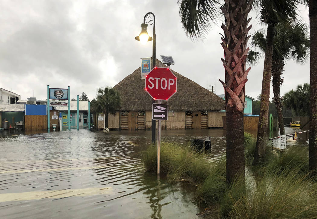 The St. Marks River overflows into the city of St. Marks, Fla., ahead of Hurricane Michael, Wednesday, Oct. 10, 2018. The hurricane center says Michael will be the first Category 4 hurricane to m ...