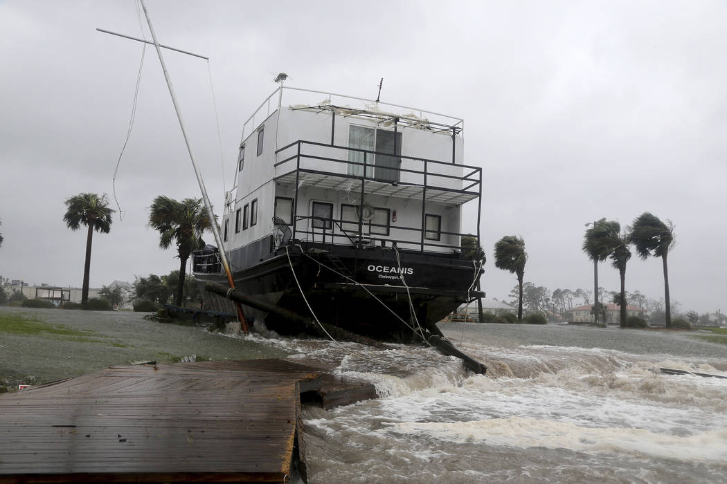 The Oceanis is grounded by a tidal surge at the Port St. Joe Marina, Wednesday, Oct. 10, 2018 in Port St. Joe, Fla. Supercharged by abnormally warm waters in the Gulf of Mexico, Hurricane Michael ...