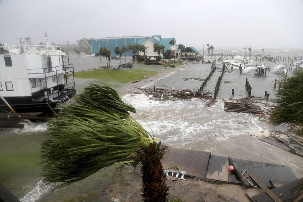 Boats lay sunk and damaged at the Port St. Joe Marina, Wednesday, Oct. 10, 2018 in Port St. Joe, Fla. Supercharged by abnormally warm waters in the Gulf of Mexico, Hurricane Michael slammed into t ...